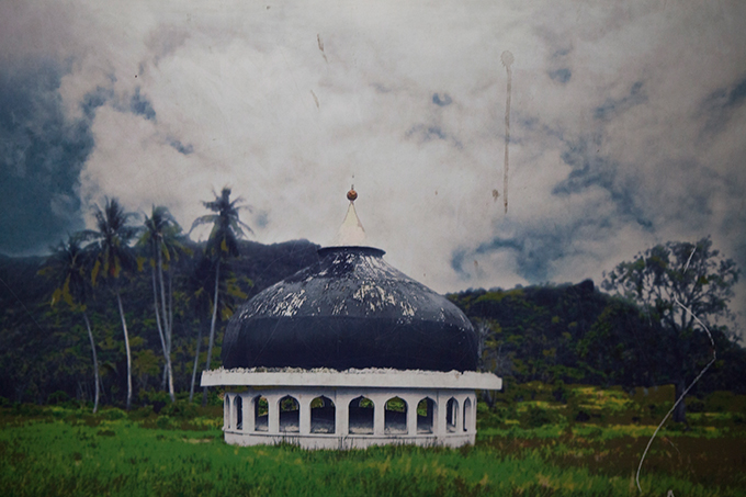 The top of a mosque moved more than a mile by the 2004 Indian Ocean tsunami, as depicted in a poster displayed at the Aceh Tsunami Museum, Banda Aceh, Indonesia.