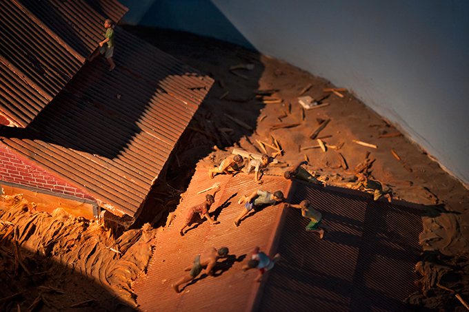 Diorama depicting people clinging to roofs, Aceh Tsunami Museum, Banda Aceh, Indonesia.