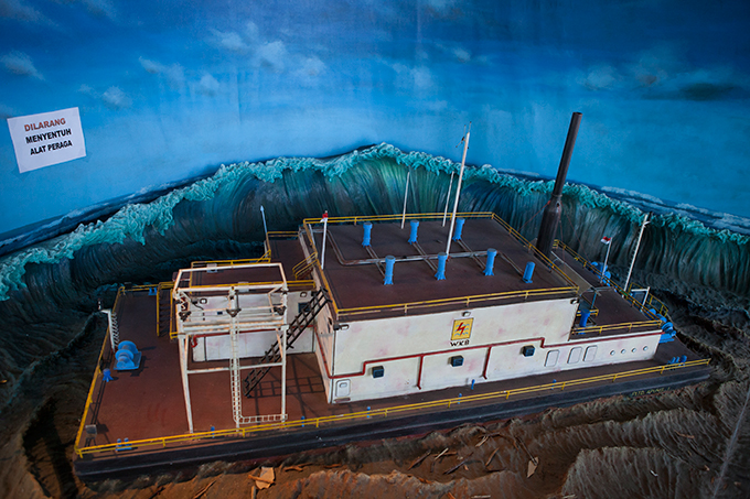 Diorama depicting a floating diesel power station, Aceh Tsunami Museum, Banda Aceh, Indonesia.