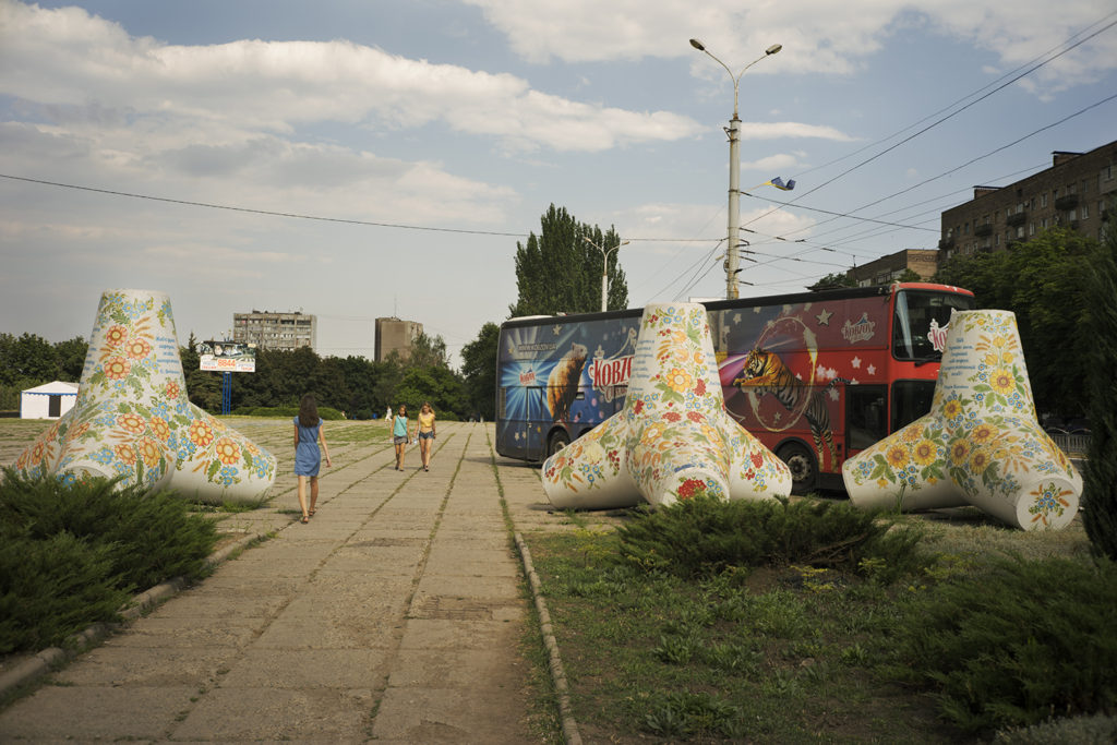 Tetrapods, normally used to build piers, have been used in Mariupol's defense, and today are found around the city painted with Ukrainian folk symbols. Mariupol, Ukraine, July 4, 2016. Photo: Ivan Sigal